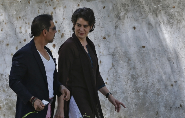 Priyanka Gandhi and husband Robert Vadra leave after casting their vote at a polling station in Delhi, 2014. (Photo: Reuters)