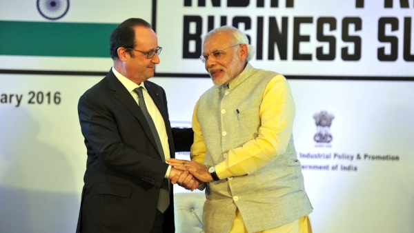 Indian Prime Minister Narendra Modi greeting French President Francois Hollande. (Photo: IANS)