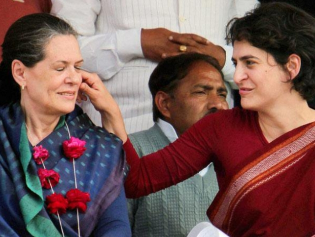 "Priyanka Gandhi pulls Sonia Gandhi's cheeks during a public rally. (Photo Courtesy: Twitter/<a href=""https://twitter.com/search?f=images&amp;vertical=default&amp;q=Priyanka%20Gandhi%20Sonia%20Gandhi&amp;src=typd"">@Butchikotaiah</a>)"