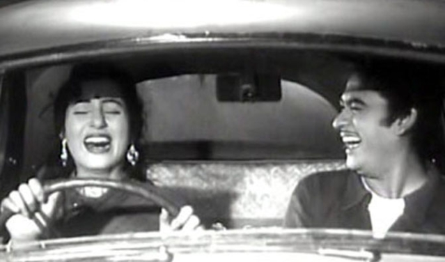 Madhubala and Kishore Kumar in a comic scene from <i>Chalti Ka Naam Gaadi</i>