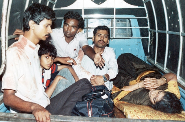 Unidentified passengers from the hijacked Pan Am airliner sit in an official government truck being brought to the local Jinnach hospital for medical treatment in Karachi, Pakistan on Friday, September 6, 1986. (Photo: AP)