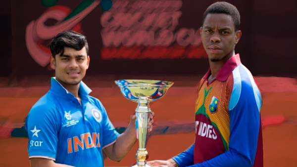 "India U-19 captain Ishan Kishan and West Indies U-19 captain Shimron Hetmyer pose with the U-19 World Cup ahead of the final. (Photo: <a href=""https://twitter.com/ICCMediaComms"">ICC Media Twitter</a>)"