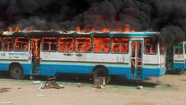 Kaithal : Jat community members torch a Haryana Roadways bus during their agitation for reservation. (Photo: PTI)