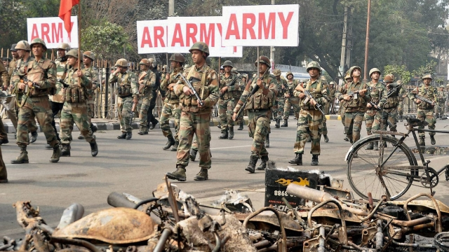 Rohtak: Indian Army men conducting Flag March on Saturday after protests for OBC status for Jats turned violent. (Photo: PTI)