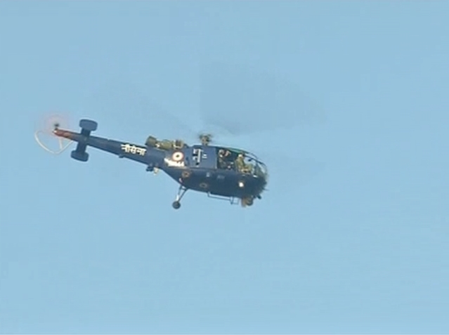Indian Navy's Chetak helicopter searching for missing student. (Photo Courtesy: ANI)