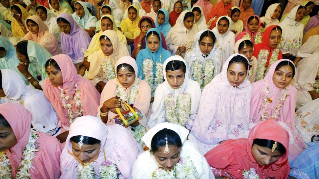 Women of the Dawoodi Bohra Muslim sect during a mass marriage function in Mumbai. The Dawoodi Bohra sect still carries out female genital mutilation (Photo: Reuters)