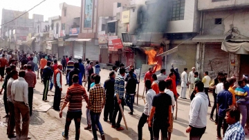 Protesters set shops on fire during Jat agitation in February 2016.