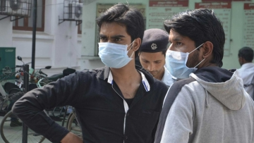 Men wear masks as a preventive measure to swine flu.