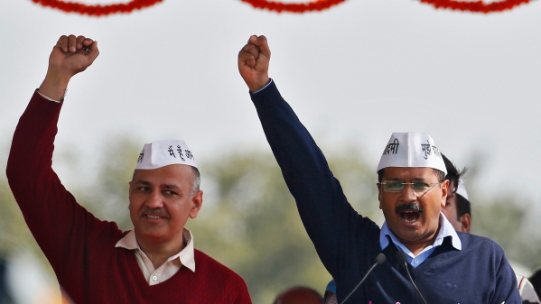 Arvind Kejriwal after taking oath as Delhi Chief Minister with Deputy CM Manish Sisodia at Ramlila Maidan. (Photo: Reuters)