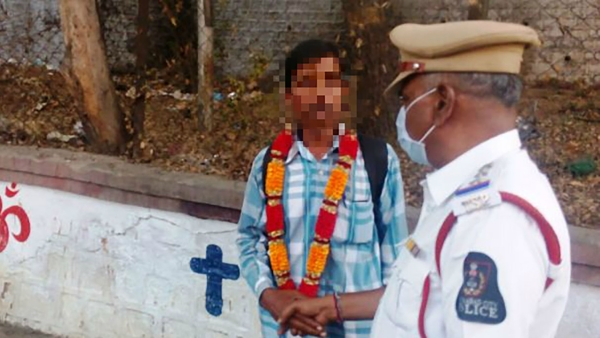 This man was garlanded after he was caught urinating. (Photo: The News Minute)