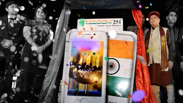 BJP Senior leader Murli Manohar Joshi, Director of Ringing Bells, Mohit Goel and CEO, Dhaarna Goel during the launch of Smartphone-Ringing Bells Freedom 251 on 17 February. (Photo: PTI/Altered by <b>The Quint</b>)