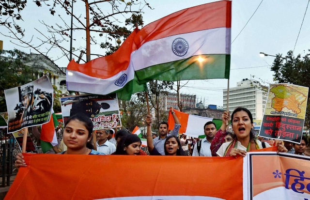 Activists participate in 'March for Bharat' with the national flag to stop anti-national activities, in Kolkata on Thursday. (Photo: PTI)