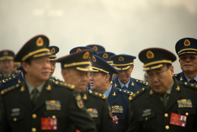 Delegates from China's People's Liberation Army (PLA) stand in line as they arrive at the Great Hall of the People to attend a session of National People's Congress in Beijing. (Photo: AP)