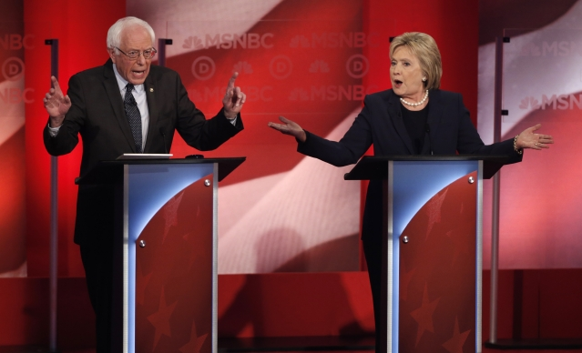 Democratic U.S. presidential candidate and Senator Bernie Sanders (L) and former Secretary of State Hillary Clinton speak simultaneously as they discuss issues during the Democratic presidential candidates debate at the University of New Hampshire in Durham, New Hampshire (Photo: Reuters)