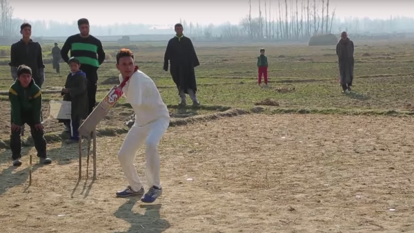 "Amir Hussain Lone playing cricket (Photo Courtesy: YouTube.com/<a href=""https://www.youtube.com/watch?v=Av3tHPn6VoI"">Barcroft Tv</a>)"