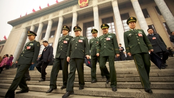 Delegates from the Chinese People's Liberation Army (PLA) leave the Great Hall of the People in Beijing, Friday, 4 March 2016.  (Photo: AP)