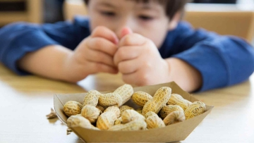 Research found that feeding peanuts to young children as little as three-months-old brings down their risk of developing peanut allergies (Photo: iStock)