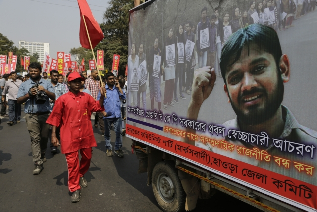 Supporters walk alongside a tableau of JNU Students' Union President Kanhaiya Kumar. (Photo: AP)