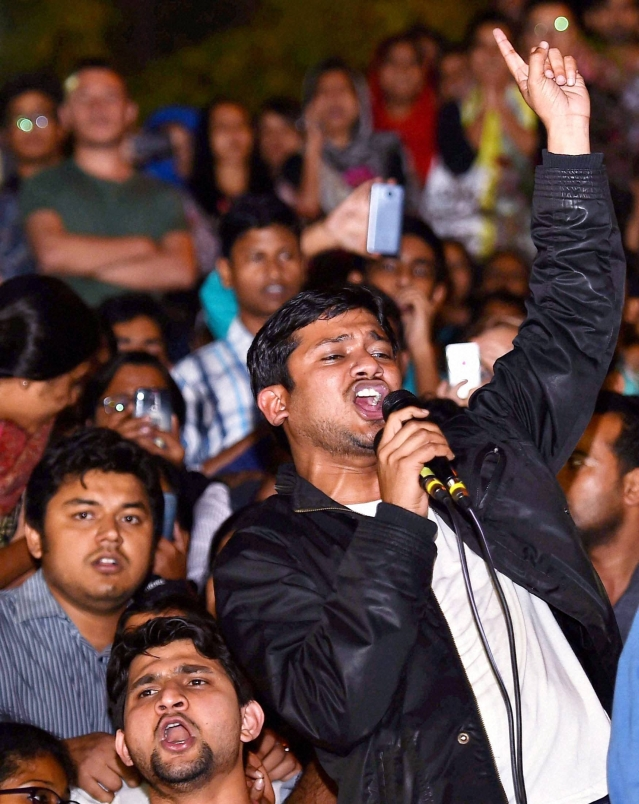JNUSU President Kanhaiya Kumar raises slogans after reaching the JNU campus in New Delhi upon his release on bail in on Thursday. (Photo: PTI)