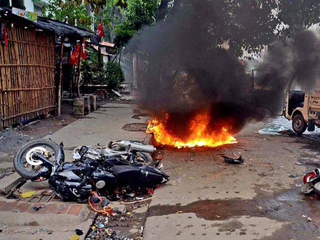 Motorcycles in flames after clashes during municipal elections in Saltlake. (Photo: PTI)