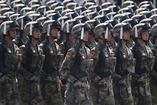 "China's 2.3 million strong military will faithfully fulfil its ""sacred duty"" of protecting the security of the nation and people's well being and carry out the noble mission of upholding world peace. (Photo: AP)"