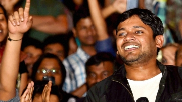 JNUSU President Kanhaiya Kumar addresses students after reaching at the JNU campus upon his release on bail, in New Delhi on Thursday. (Photo: PTI)