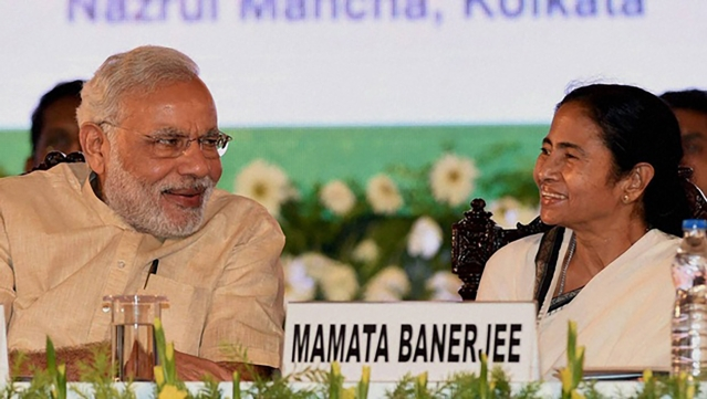 In this file photo, Prime Minister Narendra Modi is chatting with West Bengal Chief Minister Mamata Banerjee. (Photo: PTI)