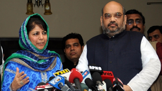 Photo of Mehbooba Mufti and BJP President Amit Shah addressing media. (Photo: PTI)
