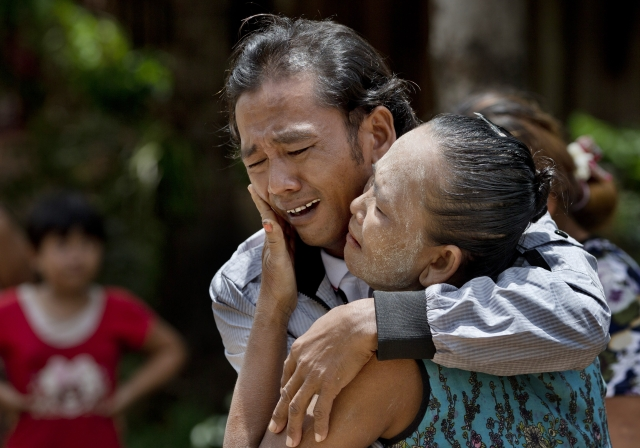 In this  16 May 2015 file photo, former slave fisherman Myint Naing and his mother, Khin Than, cry as they are reunited after 22 years at their village in Mon State, Myanmar. (Photo: AP)