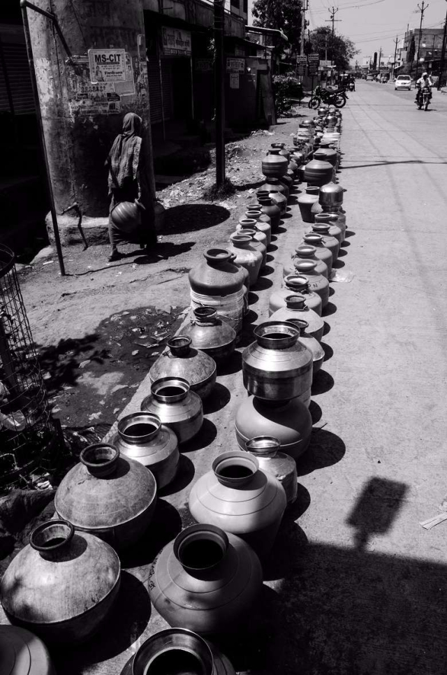 The streets of Latur town are perpetually lined with steel jugs in anticipation of a tanker's arrival. (Photo: Ameya Marathe, curated by Nikhil Inamdar)