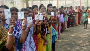 Voters  wait in a queue to cast votes at a polling station during the state assembly elections in Kharagpur, West Bengal. (Photo: PTI)