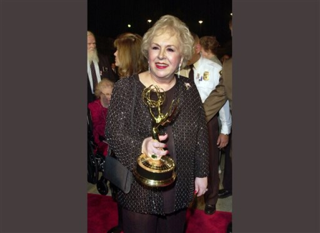 "File photo of Doris Roberts holding  her Emmy for outstanding supporting actress in a comedy series for her work on ""Everybody Loves Raymond"", on 4 November 2001."