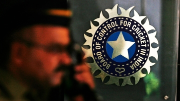 A policeman standing in front of the BCCI logo. (Photo: Reuters)