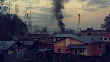 "Smoke rising from the army bunker. (Photo Courtesy: Twitter/<a href=""https://twitter.com/ArsilanAziz/status/719881800760299520"">@ArsilanAziz</a>)"