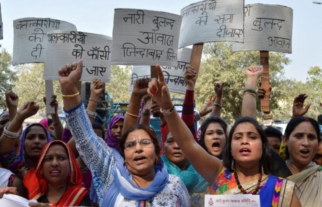 Women protest in Gurgaon against reports of gang rape incidents in Murthal. (Photo: PTI)