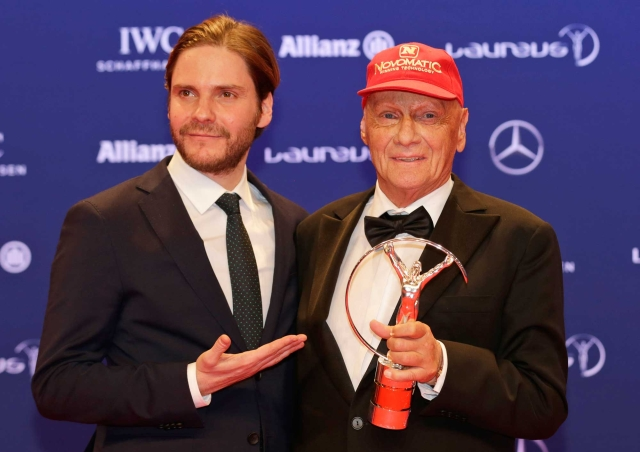 Former Formula One driver Niki Lauda, right, poses with actor Daniel Bruehl who starred him in a movie, as he shows off a Laureus Lifetime Achievement Award. (Photo: AP)