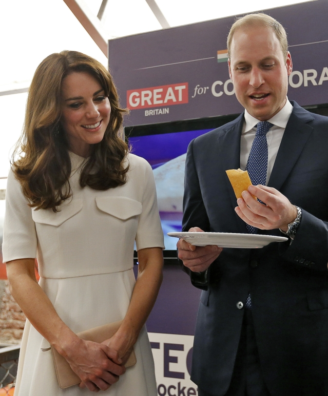 "Prince William eats a ""dosa""  as Kate watches during an event involving young entrepreneurs in Mumbai. (Photo: AP)"