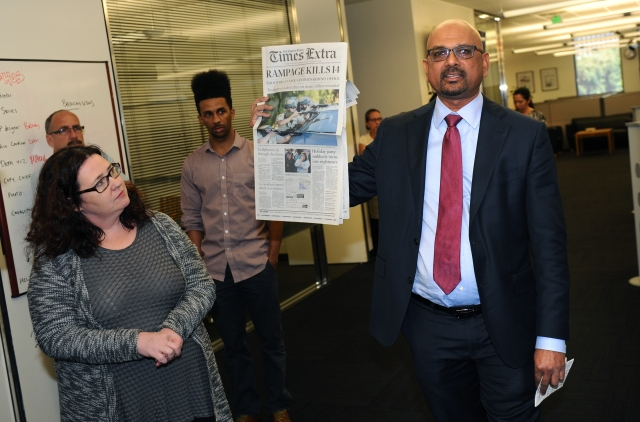Editor-in-Chief and Publisher Davan Maharaj, with Deputy Managing Editor, Megan Garvey, holds up a special edition of The Los Angeles Times' coverage of the San Bernardino attack. (Photo: AP)