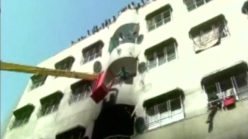 Nine fire tenders and five water tankers at the spot to rescue people. (Photo: ANI)