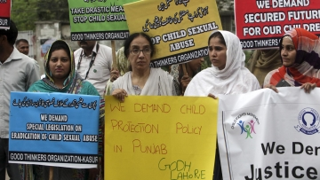 Activists of Pakistani NGO PPA (Pakistan Pediatric Association Punjab) hold placards in a protest against child abuse in Lahore, Pakistan on 13 August, 2015.(Photo: Reuters)