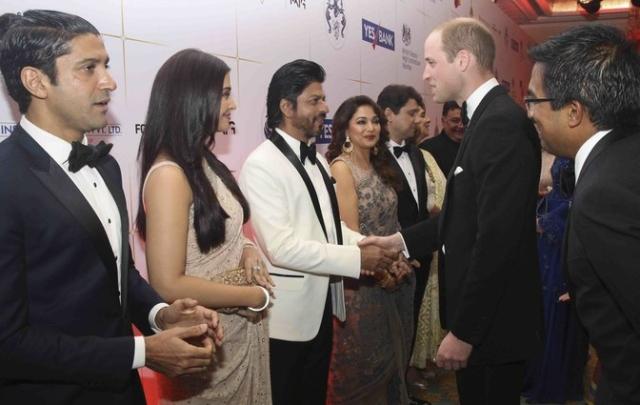 Britain's Prince William shakes hands with Shah Rukh Khan while Aishwarya Rai and Farhan Akhtar wait for their turn (Photo: Reuters)