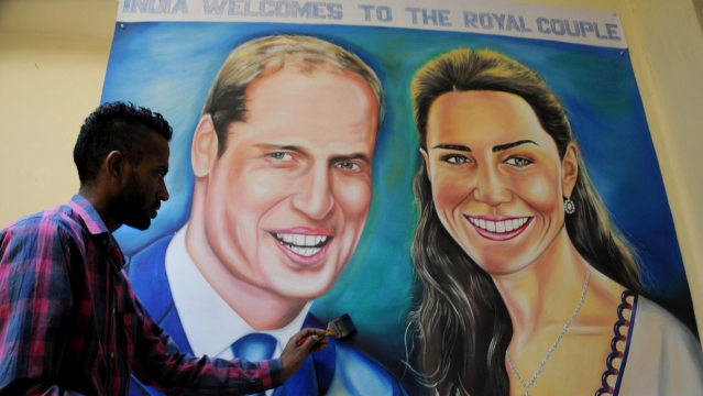 Artist Jagjot Singh Rubal giving final touches to the painting of Prince William and Kate Middleton ahead of their tour of India in Amritsar, on April 9, 2016. (Photo: IANS)