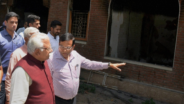 Haryana Chief Minister ML Khattar visits the house of  Capt. Abhimanyu that was set on fire by some people during the agitation for reservation recently, in Rohtak on Monday. (Photo: PTI)