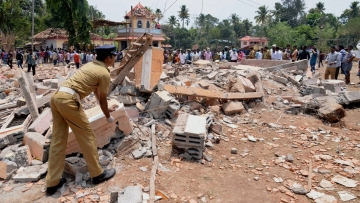 A view of a collapsed building after a massive fire broke out during a fireworks display in Paravoor, north of Thiruvananthapuram, Kerala on Sunday. (Photo: PTI)
