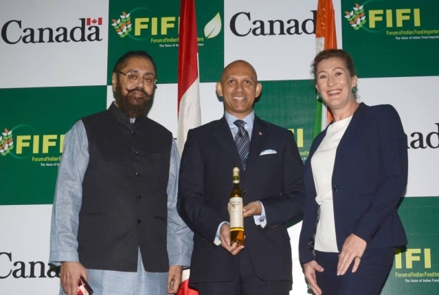 "High Commissioner Nadir Patel launches a new Canadian ice-wine in India. (Photo Courtesy: <a href=""https://www.facebook.com/CanadainIndia/photos/pb.161821560512888.-2207520000.1461058568./1248707825157584/?type=3&theater"">Facebook.com</a>)"