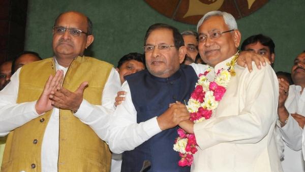 Bihar Chief Minister Nitish Kumar by Sharad Yadav (center) with JD(U) general secretary KC Tyagi in Delhi, on 10 April 2016. (Photo: IANS)