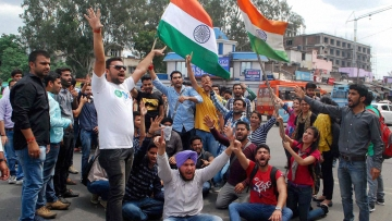 Students of Jammu University holding a protest rally over the NIT Srinagar issue in Jammu on Monday. (Photo: PTI)