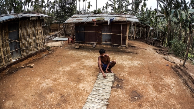 One Rabha man drying bamboo sticks in the front yard of his house. (Photo Courtesy: Anuraag Baruah)
