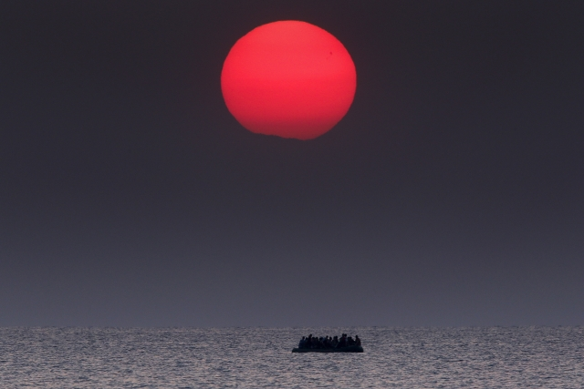 An overcrowded inflatable boat with Syrian refugees drifts in the Aegean sea between Turkey and Greece after its motor broke down off the Greek island of Kos, 11 August 2015. <i>Reuters</i> and <i>The New York Times</i> shared the<i> Pulitzer Prize</i> for breaking news photography for images of the migrant crisis in Europe and the Middle East. (Photo: Reuters/Yannis Behrakis)