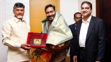 Andhra Pradesh Chief Minister N Chandrababu Naidu with actor Ajay Devgn. (Photo courtesy: <i>TNM</i>)